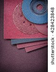 Small photo of Composition of abrasive equipment on sandpaper.