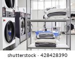clean stuff is on the rack at... | Shutterstock . vector #428428390