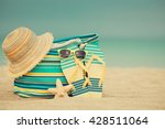 flip flops and bag on sandy... | Shutterstock . vector #428511064