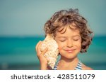 child relaxing on the beach... | Shutterstock . vector #428511079