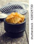 crinkle cut potato chips on... | Shutterstock . vector #428529730