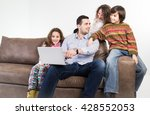 family at home sitting at sofa | Shutterstock . vector #428552053