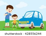 dad and son looking at car. | Shutterstock .eps vector #428556244