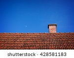 Chimney On A Red Rooftop And...