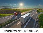 two new modern trucks driving... | Shutterstock . vector #428581654