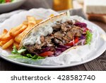greek gyros with fries and salad | Shutterstock . vector #428582740