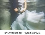wedding couple underwater... | Shutterstock . vector #428588428