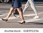 two pedestrians walking on a... | Shutterstock . vector #428592256