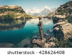 young man fishing on lake with... | Shutterstock . vector #428626408