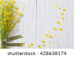 yellow flowers on wooden... | Shutterstock . vector #428638174