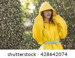 woman wearing yellow raincoat... | Shutterstock . vector #428642074