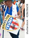 Small photo of WASHINGTON - MAY 29: A supporter of presumptive Republican presidential candidate Donald Trump holds a sign at the Rolling Thunder rally on May 29, 2016 in Washington, DC