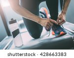 closeup portrait of a man tying ... | Shutterstock . vector #428663383