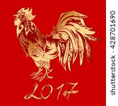 golden rooster on a red... | Shutterstock .eps vector #428701690