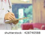 male doctor with stethoscope... | Shutterstock . vector #428740588