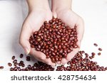 hands holding red beans... | Shutterstock . vector #428754634