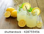 Two Mason Jar Glasses Of...