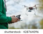 Man controling a drone. - stock photo