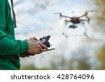 Man controling a drone. - stock photo