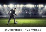businessman kicking ball | Shutterstock . vector #428798683