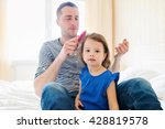 father combing hair of his... | Shutterstock . vector #428819578