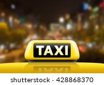 Taxi Car On The Street At Nigh...