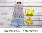 sleeveless top and blue shorts. ... | Shutterstock . vector #428892484