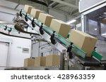 cardboard boxes on conveyor... | Shutterstock . vector #428963359