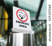 Small photo of Sign of smoking area in the city