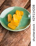 Small photo of Delicious Sweet Pumpkin Pieces dipped in sweet syrup or sweet kesar Petha, selective focus