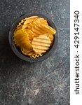 crinkle cut potato chips on... | Shutterstock . vector #429147340