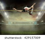 athlete in action of high jump. | Shutterstock . vector #429157009