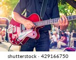 man with a red electric guitar... | Shutterstock . vector #429166750
