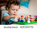 a baby boy playing with lego ... | Shutterstock . vector #429194770