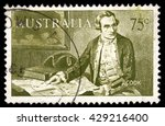 Small photo of London, UK, July 17 2010 - Old Australia half crown postage stamp showing a portrait of an Aborigine man