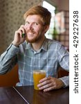 a man in a cafe drinking tea at ...   Shutterstock . vector #429227638