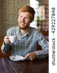 a man in a cafe drinking tea at ... | Shutterstock . vector #429227848