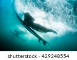The Girl Dives Under A Wave....