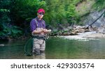 a fisherman chooses bait for... | Shutterstock . vector #429303574