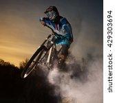 downhill cycling. man jump on a ... | Shutterstock . vector #429303694
