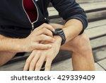 urban jogger checking at heart... | Shutterstock . vector #429339409