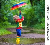 Little Boy Playing In Rainy...