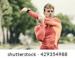 young athletic man stretching... | Shutterstock . vector #429354988