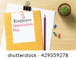 Small photo of Employee Appreciation Day, message on the white paper / business concept / wood desk , copy space / business concept / view from above, top view