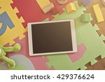 top view on a tablet device on...   Shutterstock . vector #429376624
