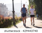 healthy mature couple jogging... | Shutterstock . vector #429443740