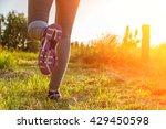 fitness girl running at sunset... | Shutterstock . vector #429450598