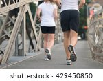 healthy mature couple jogging... | Shutterstock . vector #429450850