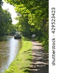 Cyclists On The Tow Path Of Th...