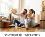 young couple moving in new home.... | Shutterstock . vector #429689848